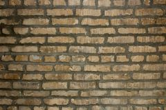 Brick wall of yellowish white brick. With uneven edges Stock Images