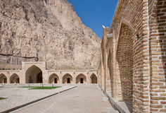 Brick walls and arches of the caravanserai in the high mountains of Middle East Royalty Free Stock Images
