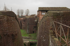 Brick walls and moat around Medici Fortress of Santa Barbara. Pistoia. Tuscany. Italy. Stock Photo