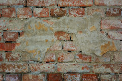 Brick walls, old wall with crumbling plaster, texture, background Royalty Free Stock Image