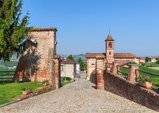 Brick walls and small church in Italy. Royalty Free Stock Photo
