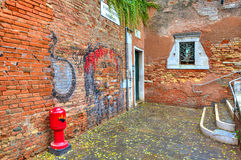 Brick walls and small courtyard in Venice, Italy. Royalty Free Stock Photo