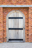 Brick walls and wooden doors Royalty Free Stock Photo