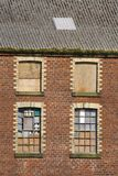 Brick warehouse. Windows and brickwork of an old warehouse royalty free stock photo