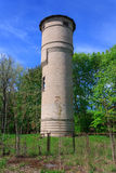 Brick water tower in the forest Royalty Free Stock Photos