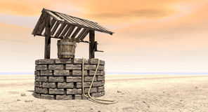 Wishing Well With Wooden Bucket On A Barren Landscape. A brick water well with a wooden roof and bucket attached to a rope in a flat barren landscape with an Royalty Free Stock Photos