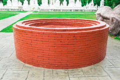 Brick Well in front of Ossuaries in Temple Stock Photos