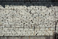 Brick white wall with barbed wire. Old brick white wall with barbed wire, fence, prison, border, background, protection, security, freedom, metal, barrier royalty free stock photo