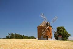 Brick windmill in a field of corn. Stock Photos