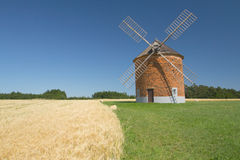 Brick windmill in a field of corn. Royalty Free Stock Photos