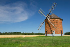 Brick windmill in a field of corn. Royalty Free Stock Image
