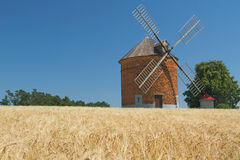 Brick windmill in a field of corn. Stock Photo