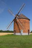 Brick windmill in a green grass Stock Photography