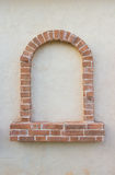 Brick window as a frame on wall Stock Photos