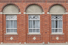 Brick Window Wall. Great Brick work on this wall around three wonderful windows Stock Images