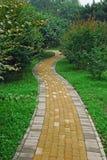 A brick windy garden path Stock Photo