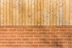 Brick and wood wall. It is made of hardwood lumbers and brick-layer Stock Images