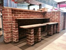 Brick wooden bench stock images