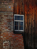 Brick and wooden wall with window Royalty Free Stock Photo