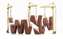Brick www letters carried by construction cranes forming www word Royalty Free Stock Image