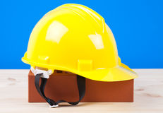 Brick and yellow hard hat Royalty Free Stock Images