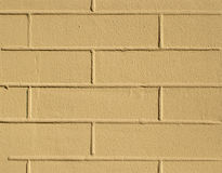Brick yellow wall texture background Stock Images