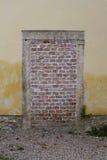 Bricked entrance. Old urban bricked entrance door Royalty Free Stock Images