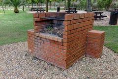 Bricked grillfest på parkera royaltyfri foto