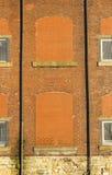 Bricked herauf veraltete Fenster in geüberholter Baumwollspinnerei lizenzfreie stockbilder