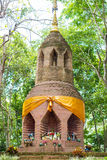 Bricked pagoda in forest. Bricked pagoda of buddhism in natural forest in countryside of thailand Royalty Free Stock Photo