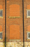 Bricked up disused windows in refurbished cotton mill Royalty Free Stock Images
