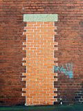 Bricked Up Doorway. Unsubtle bricking up of a doorway Royalty Free Stock Photo