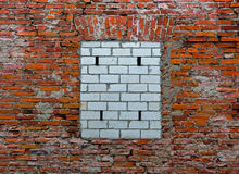 Bricked up window on old brick wall Stock Images