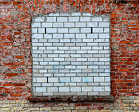 Bricked-up window on old brick wall Stock Photo