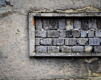 Bricked up window in old wall Stock Photos