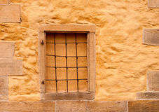 Bricked-up window in the wall of  ancient church Royalty Free Stock Images