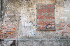 Bricked up window in a weathered wall Royalty Free Stock Image