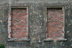 Bricked up windows in old building Royalty Free Stock Image