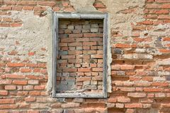 A bricked window with wooden frame on the wall of red brick stock photography
