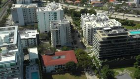 Brickell Miami housing aerial descent. USA stock video footage