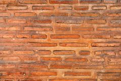 A bricking wall. A ansient bricking wall in orange color Royalty Free Stock Photos