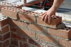 Bricklayer. Building an outside wall Stock Photo