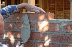 Bricklayer. Building the wall of a house Stock Photos
