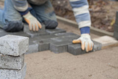 Bricklayer. The job of a bricklayer requires skill and experience Royalty Free Stock Image