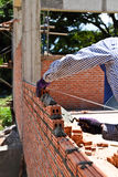 Bricklayer. Laying a brick to building construction Royalty Free Stock Photos
