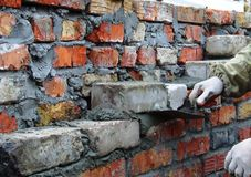 Bricklayer. Mason building brick wall Royalty Free Stock Photography
