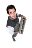 Bricklayer with a block Stock Photography