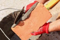 Bricklayer with brick Royalty Free Stock Photos