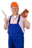 Bricklayer with brick and trowel Royalty Free Stock Image