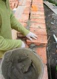 Bricklayer bricklaying brick home wall royalty free stock photography